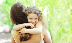 Mother's day, family, childhood and people concept - happy daugh