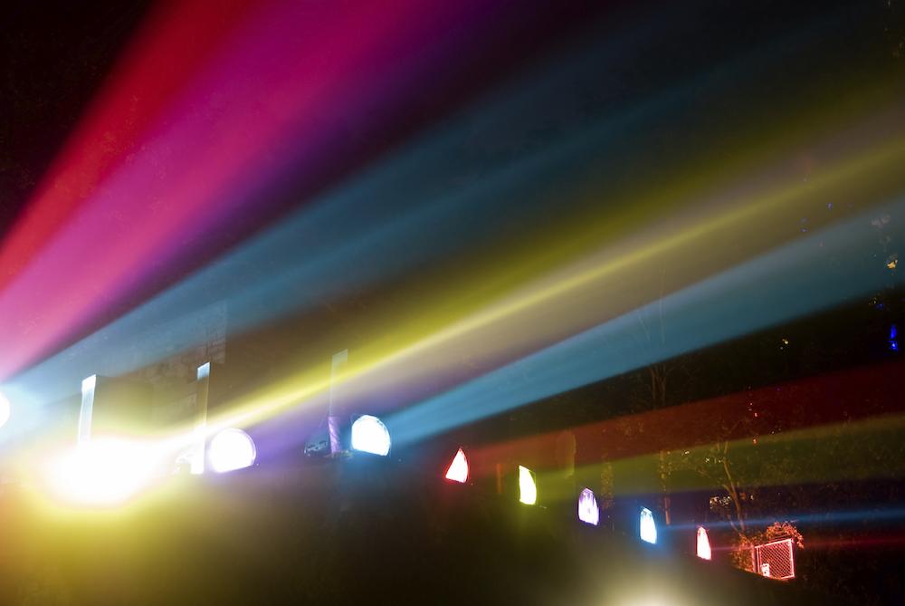 multi-colored spotlights create streaks at night