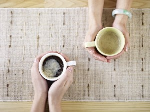 hands holding coffee
