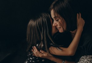 Loving,Mother,And,Daughter,Gently,Hug,Each,Other,,They,Smile