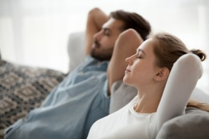 Relaxed,Couple,Resting,On,Comfortable,Couch,,Happy,Calm,Man,And