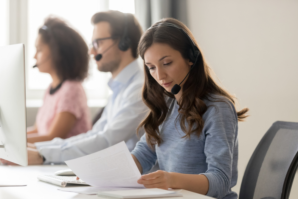Telemarketing,Representative,Or,Sales,Agents,Sitting,At,Workplace,Wearing,Headset