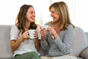 Mother,And,Daughter,Drink,Tea,At,Home