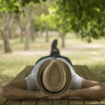 Restful,Young,Man,Wearing,A,Straw,Hat,Laying,Down,On