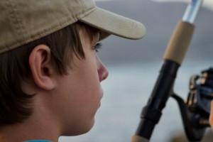 Caucasian,Teenage,Boy,Wearing,A,Baseball,Cap,,Fishing,,Close,Up