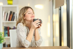 Portrait,Of,A,Woman,Breathing,And,Holding,A,Coffee,Mug