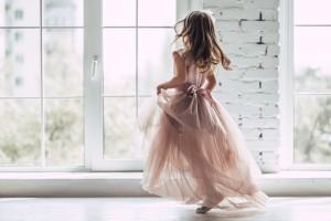 Little,Cute,Girl,In,Beautiful,Dress,Is,Dancing,Near,The